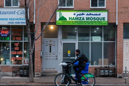 Toronto, ON Canada 12/27/2019: Street scene along the Queen Street section of Parkdale. Sajtókép