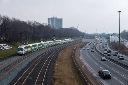 Toronto, ON Canada 12/27/2019: GO trains on their way out of Toronto along the Gardiner Expressway.