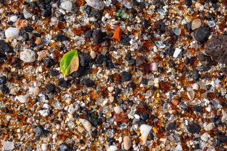 Glass Beach - EleÊ»ele, Kauai, Hawaii. Close up of rounded glass and lava rock fragments that litter the beach. Stock fotó