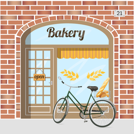 heads old building facade: Bakery shop building facade of red brick . Bicycle with bread in basket. EPS 10 vector.
