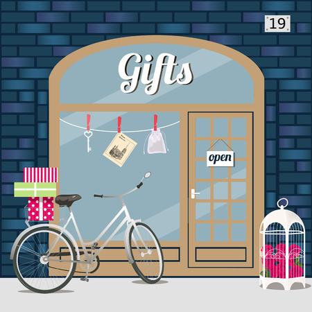 선물 가게 파란색 벽돌의 외관입니다. 바구니에 선물 상자와 전면에 장미와 함께 birdcage 자전거. 창에서 키, sashe 및 엽서입니다. 벡터 그림 분기 EPS 10입