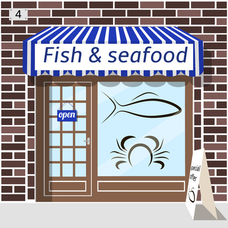 awnings: Fish and seafood shop building. Fish and crab sticker on window. Blue awnings. Brown brick facade. Advertising panel at the fore.