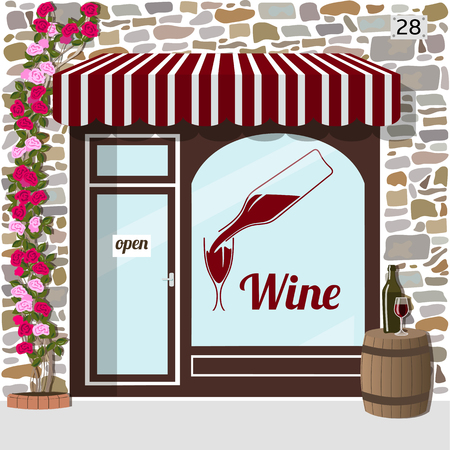 awnings windows: Wine shop building.Facade of stone. barrel with bottle and glass on it at the fore.