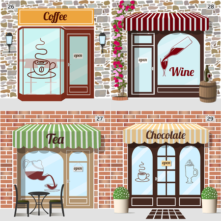 awnings: Tableand chairs at the fore of tea shop. Barrel with bottle and glass at the fore of wine shop. Beverages stickers on windows. Building facade of brick and stone.