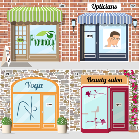 Set of health and beauty shops. Beauty salon, yoga, pharmacy, opticians shop facade.