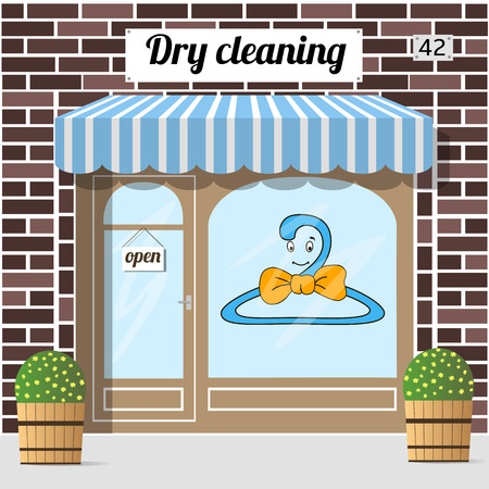 dry cleaning: Dry cleaning service. Brown brick facade building. Vector illustration.
