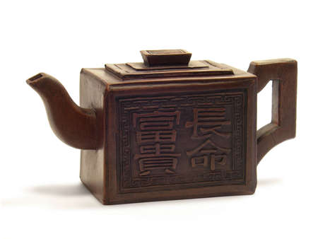Ancient Chinese handicraft clay teapot isolated on a white background.
