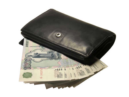 Black leather wallet bulging with Russian thousand rubles banknotes isolated on a white background. Stock Photo