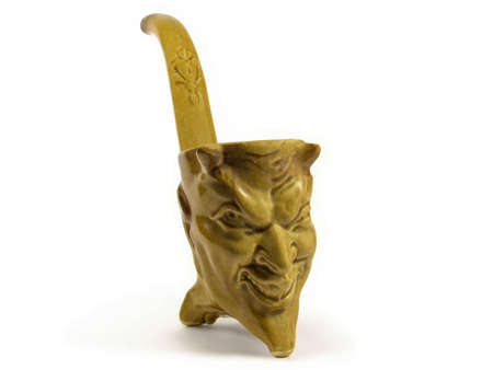 Ceramic cup made to look like a Devils head isolated on white background.