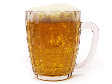 Big mug of lager beer with froth isolated on white background.