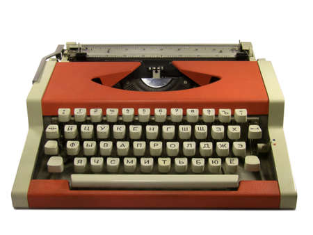 Red typewriter with cyrillic keyboard layout isolated on white background.
