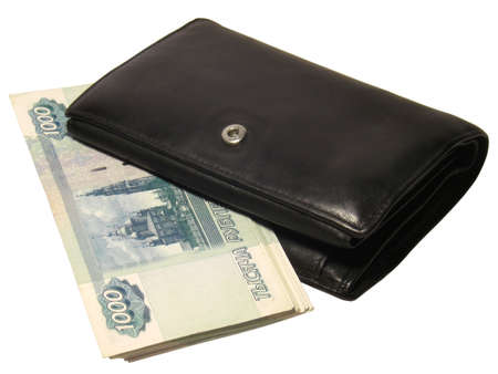 Black leather wallet bulging with Russian thousand rubles banknotes isolated on white background. Stock Photo