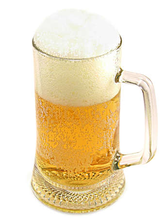 Mug of lager beer with froth isolated on white background.