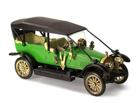 Miniature toy of retro car isolated on white background. Stock Photo