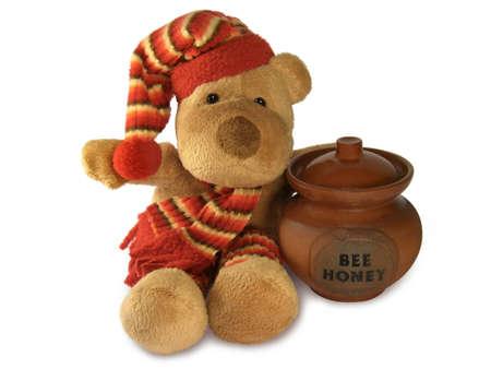 Teddy bear with honey pot.