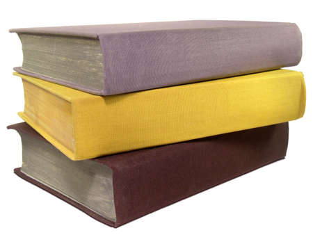 Stack of three old colorful books isolated on white background. Stock Photo