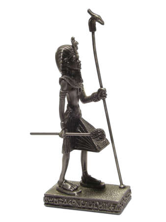 Metal statuette of Egyptian Pharaoh isolated on white background. Stock Photo