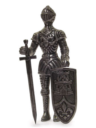 crusade: Metal knight statuette isolated on white background.