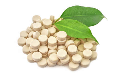 Tabletten geneeskunde bio natuurlijk op een witte achtergrond Stockfoto