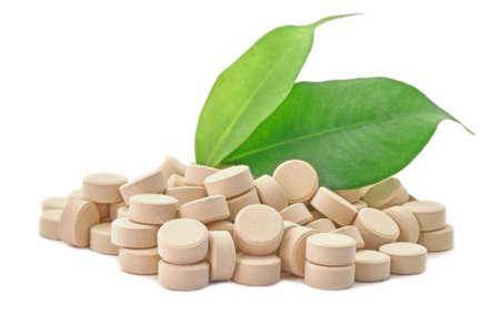 Bio pills medicine with green leaf photo