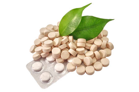 troche: Pills Bio tablets Medicine with green leaf Stock Photo