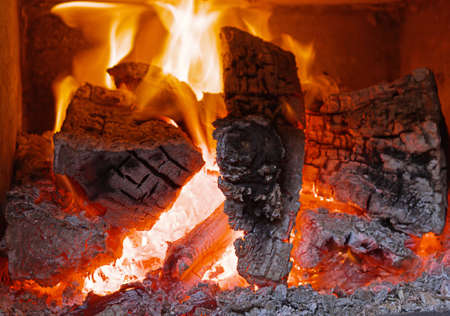 Fireplace with flame fire ashes Stock Photo