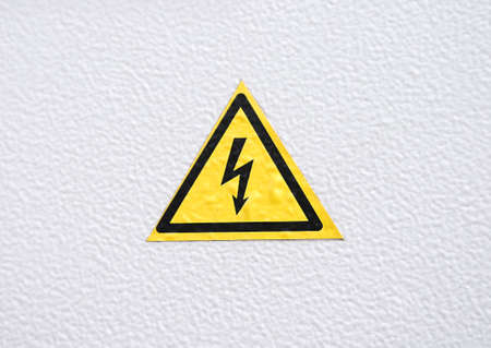 Warning Danger sign on metal textured background photo