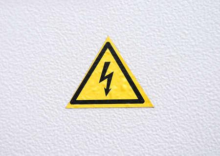 electroshock: Warning Danger sign on metal textured background