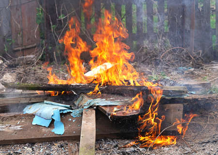 defilement: Fire Flame burnung litter toxic illegal poison clouds Stock Photo