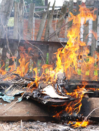 defilement: Toxic Fire Flame illegal burn litter in city poison smoke