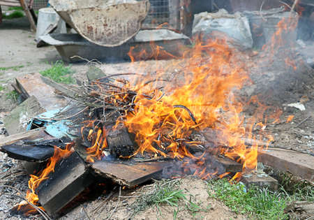 defilement: Fire illegal burn litter Flame toxic Stock Photo