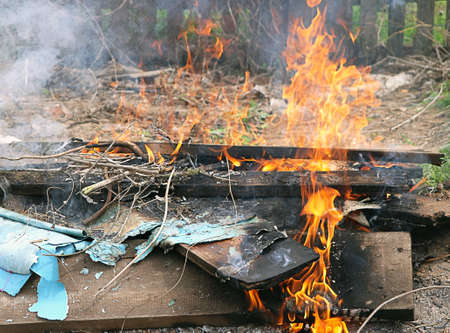 defilement: Litter burning Fire flame illegal toxic Stock Photo