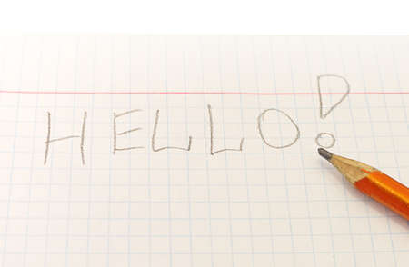 Text Hello word written by pencil on notebook sheet Stock Photo