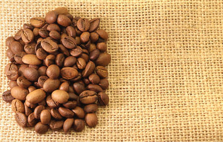 Coffee Beans on material textured background Stock Photo