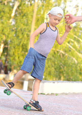Boy Child Training Skateboard jumping Outdoor Summer Sport with nature on background