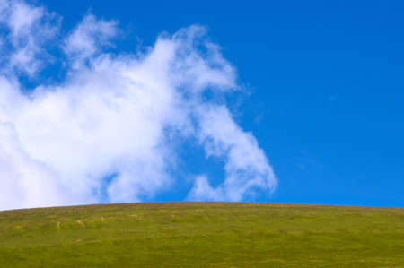cloud drift: Blue Sky with Clouds and Green Valley Background Design