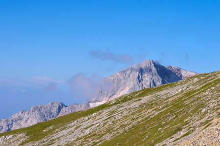 Rocky Mountains in Caucasus scenery of Fisht Peaks with Blue Sky photo