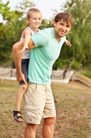 Family Father Man and Son Boy Child playing Outdoor Happiness emotion with summer nature on background photo