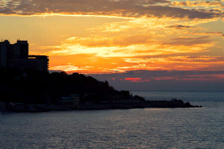 dawning: Background of dawning Sky and Sea on Sunrise with town silhouette beautiful scenery with natural orange colors