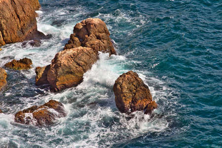 Stones in the Sea deep blue with waves Beautiful Landscape photo