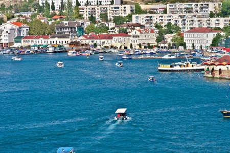 BALAKLAVA, CRIMEA, UKRAINE  Bay with boats and seaside view town photo