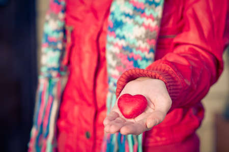 Heart shape love symbol in woman hands Valentines Day romantic greeting people relationship concept winter holiday photo