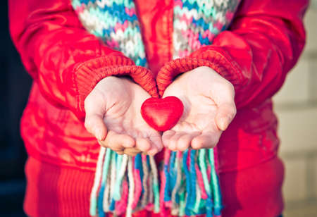greeting people: Heart shape love symbol in woman hands Valentines Day romantic greeting people relationship concept winter holiday