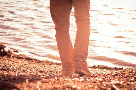 Foot man walking outdoor on beach trendy style melancholy concept