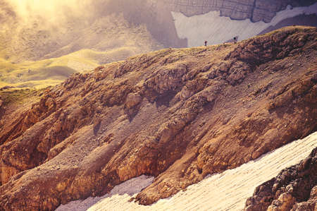Rocky Mountains with glacier snow and hikers silhouette beyond beautiful Landscape Caucasus nature Stock Photo