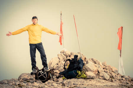 Man Traveler with hands raised on Mountain summit Traveling Mountaineering and freedom concept fog  photo