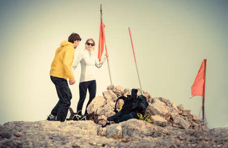 Man and Woman couple Travelers on Mountain summit with backpack Traveling Mountaineering concept fog