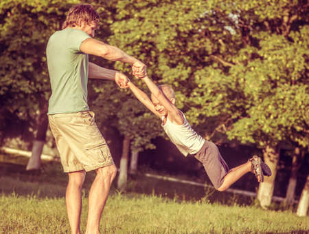 Family Father Man and Son Boy playing Outdoor Happiness emotions Lifestyle with summer nature  Stock Photo