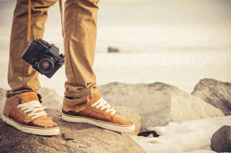 Feet man and vintage retro photo camera outdoor Travel Lifestyle vacations concept Imagens - 26608451
