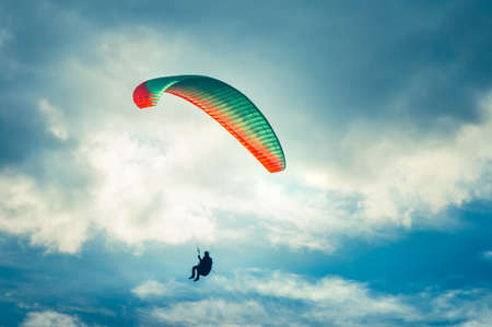parasailing: Paragliding extreme Sport with blue Sky and clouds on background Healthy Lifestyle and Freedom concept Summer Vacations